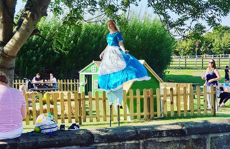 A photo of Alice at the Alice in Wonderland Event