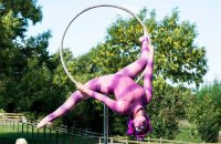 A photo of a gymnast at the Alice in Wonderland Event